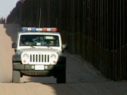 Mexican Police stop the violence spilling over the border.