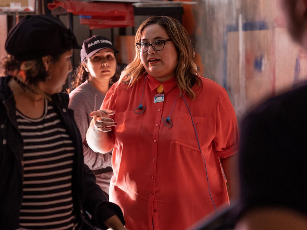 PHOTO: Creator and Showrunner Tanya Saracho works with members of the cast and crew of the Starz show, Vida.