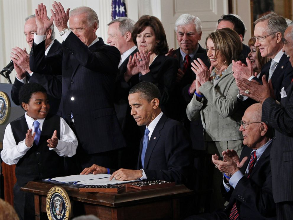 PHOTO: President Barack Obama is applauded after signing the Affordable Care Act into law in the East Room of the White House on March 23, 2010.