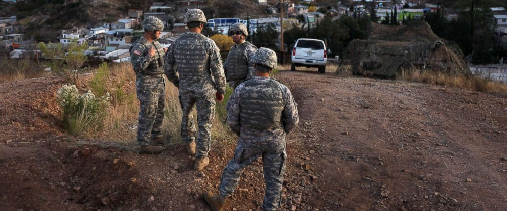 PHOTO: Arizona National Guardsmen talk while at an observation post overlooking the U.S. Mexico border in Nogales, Ariz., Dec, 7, 2010.