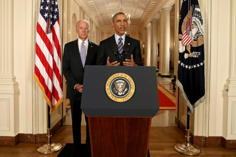 PHOTO: President Barack Obama, standing with Vice President Joe Biden, conducts a press conference in the East Room of the White House in response to the Iran Nuclear Deal, on July 14, 2015 in Washington, DC.