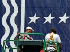 PHOTO: Workers mount a giant banner at the Tampa Bay Times Forum ahead of the Republican National Convention in Tampa, Florida, on August 24, 2012.
