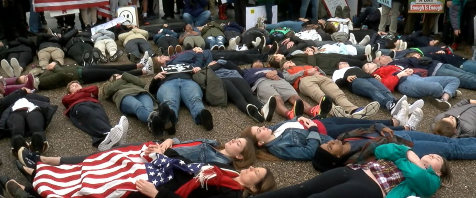 Protesters laid on the floor for several minutes to represent victims of school shootings.