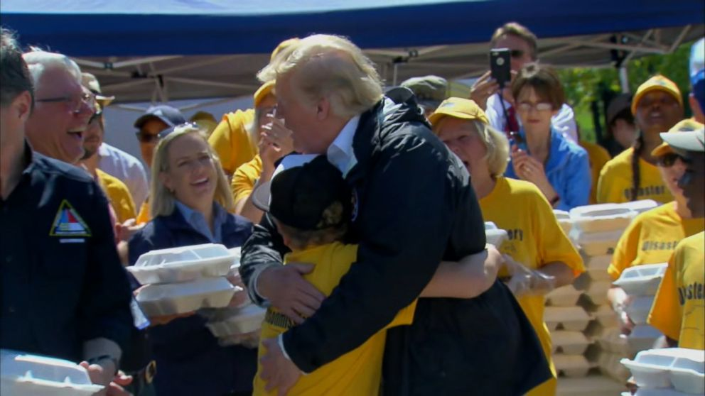 VIDEO: The president embraced a boy while handing out meals at a relief center in North Carolina.