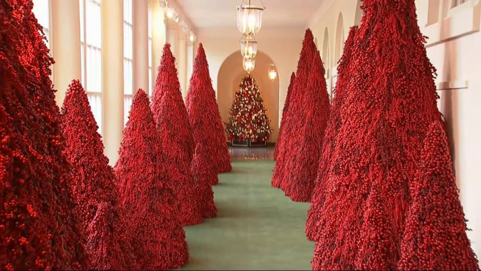 after the handmaids tale references melania trump defends her red christmas trees abc news