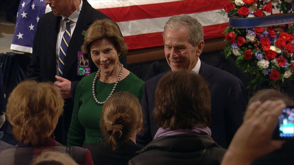 The family stopped by Tuesday night as visitors continued to pay their respects to the former president.