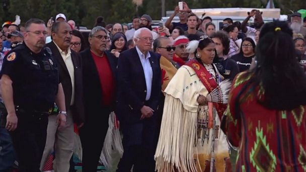 Bernie Sanders marches with Comanche Nation members