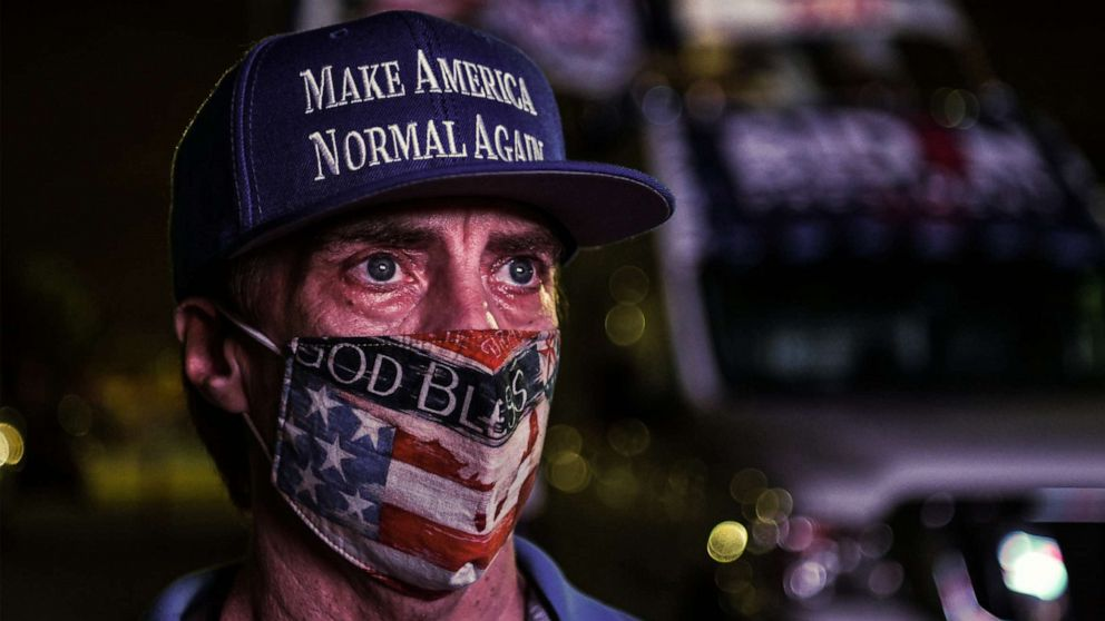 A supporter of the Democratic party attends a watch party in Miami, Nov. 3, 2020.
