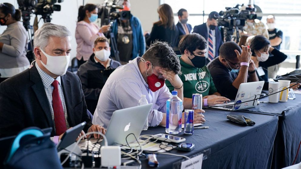 PHOTO: Election observers sit in front of the media as vote counting in the general election continues at State Farm Arena on Thursday, Nov. 5, 2020, in Atlanta.