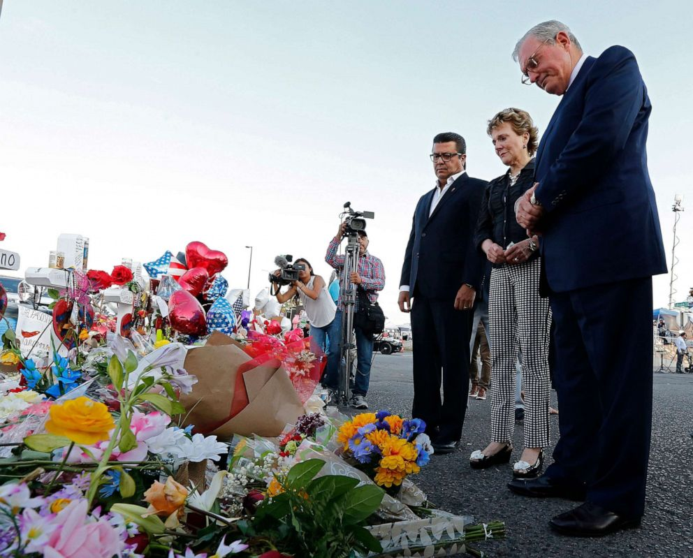 PHOTO: Juarez Mayor Armando Cabada, left, and El Paso Mayor Dee Margo, right, and his wife Adair, place flowers at the makeshift memorial outside the Walmart in El Paso, Texas, Aug. 7, 2019, where a mass shooting took place.