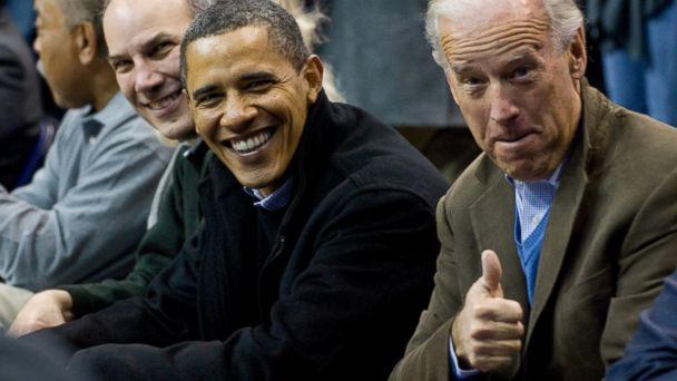 PHOTO: US President Barack Obama sits courtside alongside US Vice President Joe Biden basketball fans during the first half of the NCAA mens college basketball game between Georgetown and Duke at the Verizon Center in Washington on January 30, 2010.