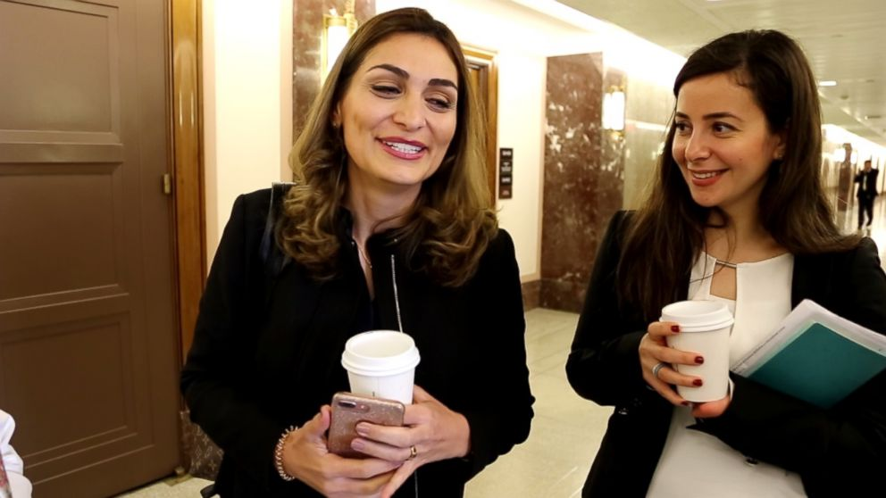 Yasmin Kayali, right, walks with Noha Alkamcha on their way to a series of congressional meetings about rebuilding their homeland, Syria.