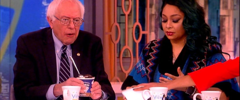 PHOTO: Presidential candidate Bernie Sanders eating ice cream on The View. On the right is Raven-Symone.