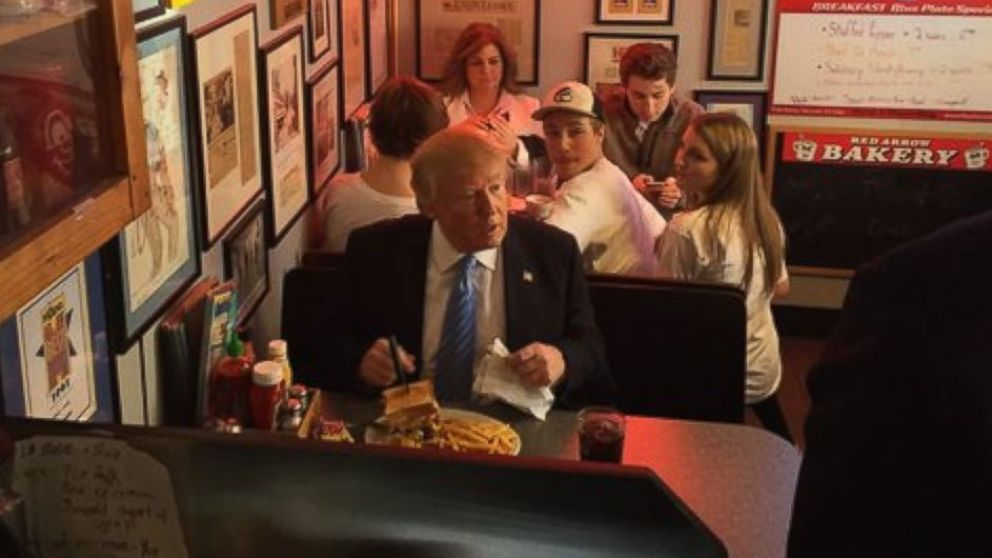 In his first real NH retail stop, Donald Trump ordered a burger at the famous Red Arrow Diner.