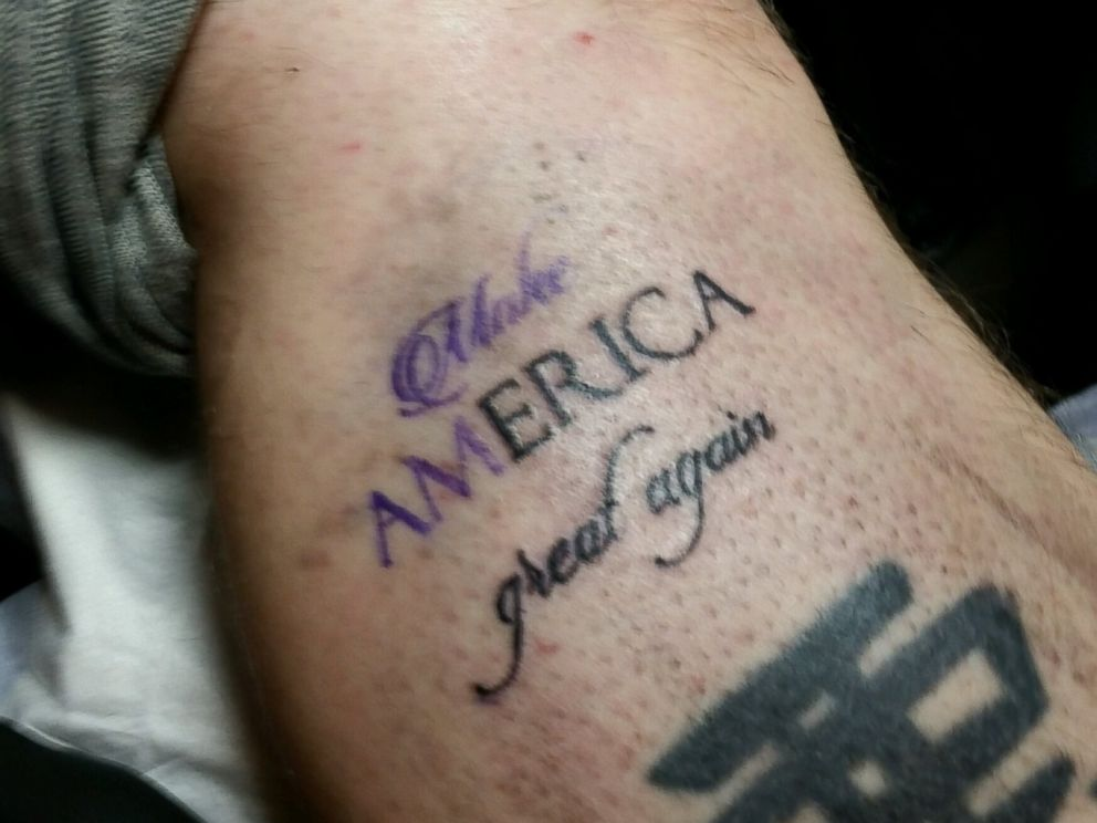 Bob Holmes, owner of The Clay Dragon Tattoo Parlor and Bobs Tattoo in Seabrook, New Hampshire, offers free Trump Stamp tattoos.
