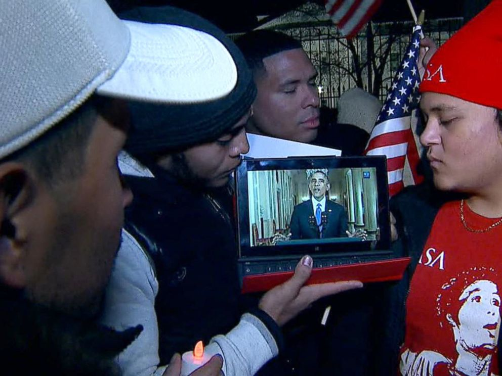 PHOTO: Immigration protesters watch President Obama address the nation on his proposed reform, Nov. 20, 2014, in Washington.