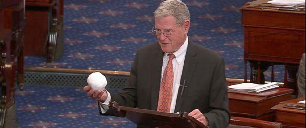 PHOTO: Sen. Jim Inhofe, R-Oklahoma, throws a snowball on the Senate floor.