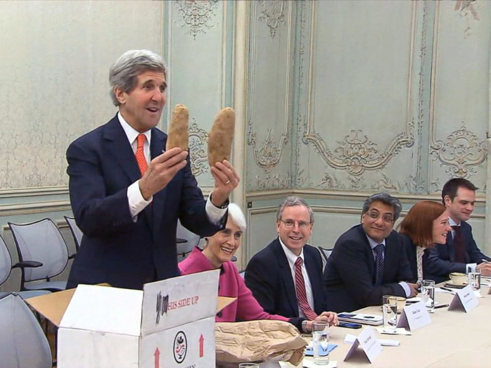 PHOTO: John Kerry gives potatoes to his Russian counterpart, Jan. 2014.