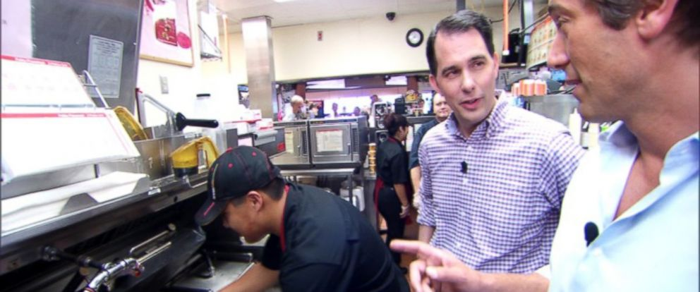 PHOTO: Gov. Scott Walker takes a tour of the McDonalds where he used to work as a high school student in Delevan, Wisconsin on July 11, 2015 accompanied by ABC News David Muir.