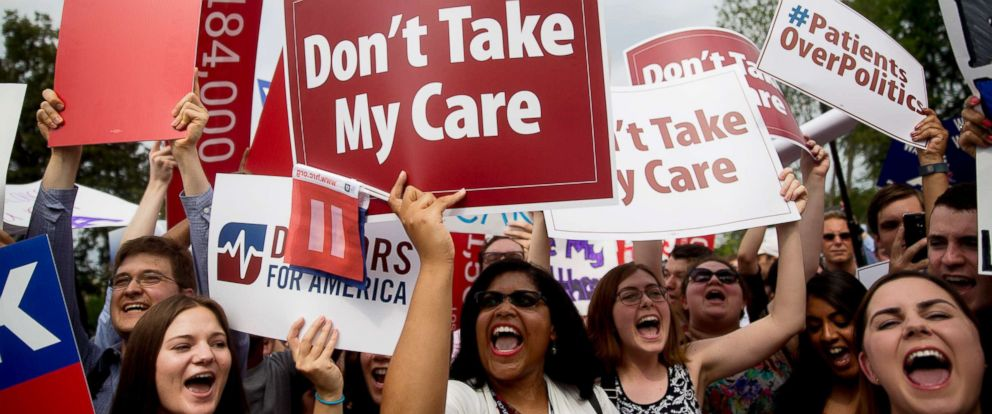 Demonstrators in support of former President Barack Obamas health-care law, the Affordable Care Act (ACA), hold up signs after the U.S. Supreme Court ruled 6-3 to save Obamacare tax subsidies outside the Supreme Court in Washington, D.C., June 25, 2015.