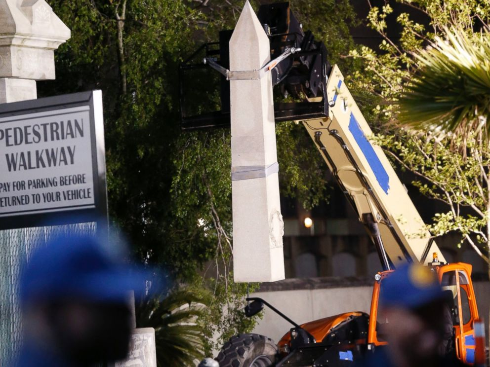 PHOTO: Workers dismantle the Liberty Place monument which commemorates whites who tried to topple a biracial post-Civil War government, April 24, 2017, in New Orleans.