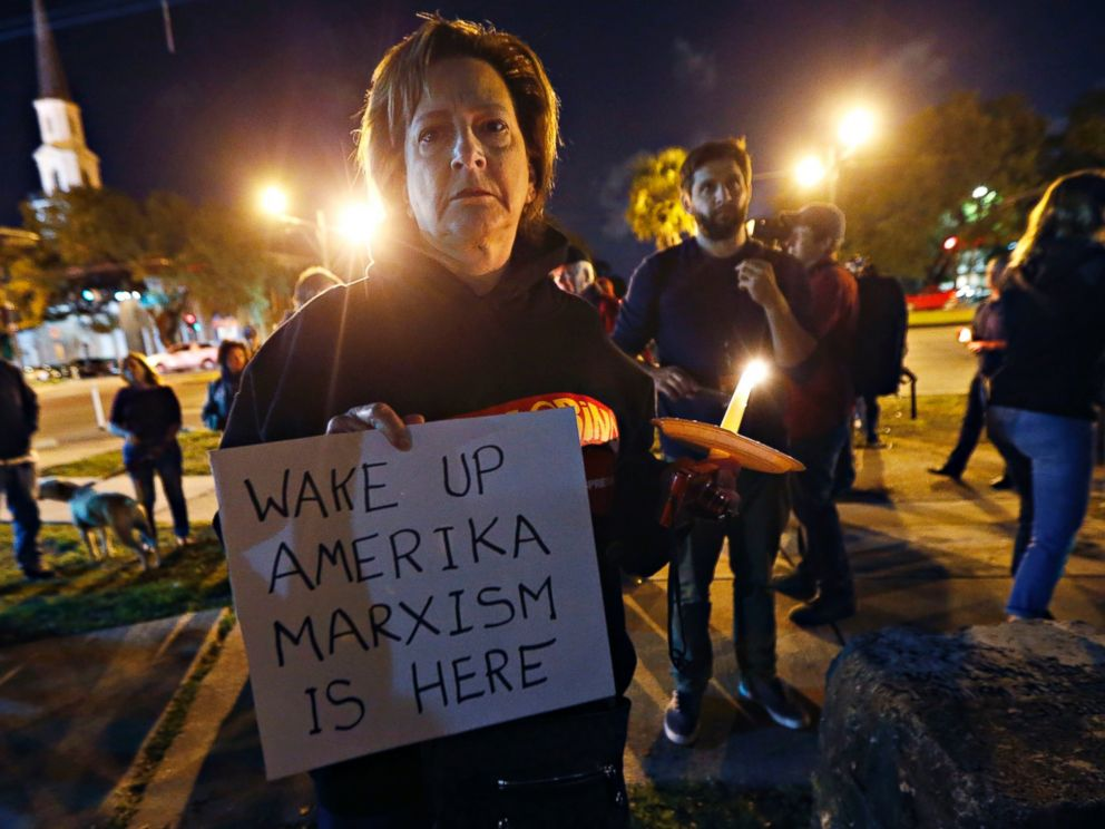 PHOTO: Dana Farley, of New Orleans, participates in a candlelight vigil at the statue of Jefferson Davis, April 24, 2017, in New Orleans before the statues removal.
