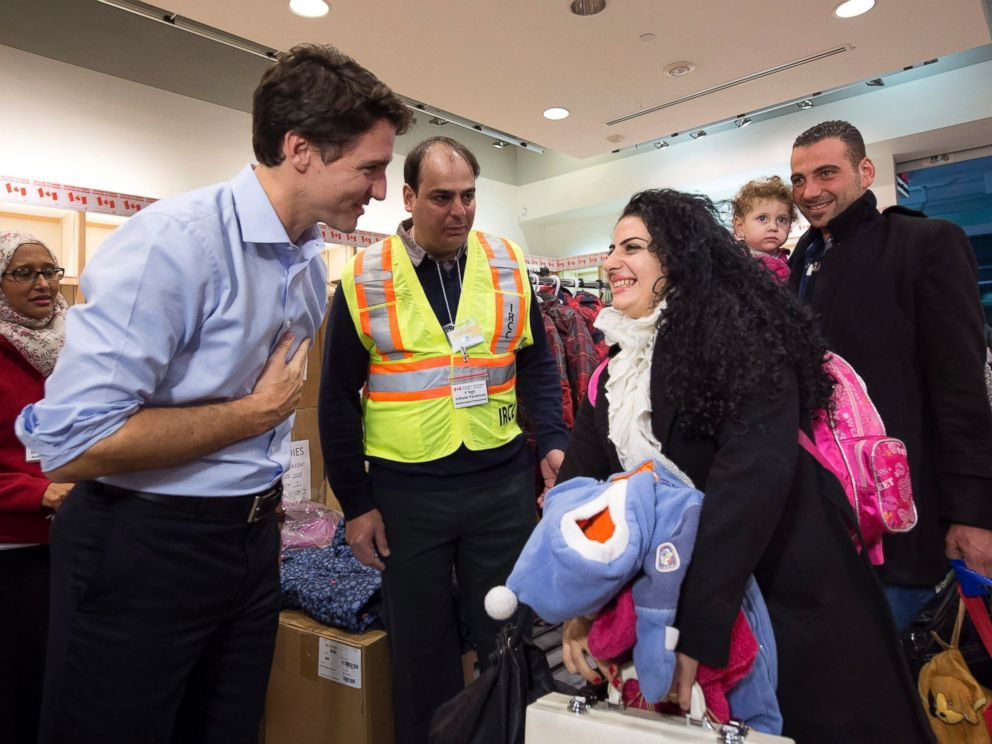 PHOTO: Canadian Prime Minister Justin Trudeau greets Syrian refugees Georgina Zires, center, Madeleine Jamkossian, second right, and her father Kevork Jamkossian as they arrive at Pearson International airport. Dec. 11, 2015, in Toronto.