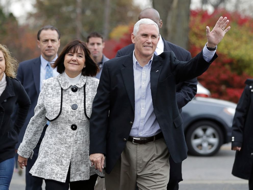 PHOTO: Republican vice presidential candidate, Indiana Gov. Mike Pence, accompanied by his wife, Karen, waves as they go to cast their ballots, Nov. 8, 2016, in Indianapolis.