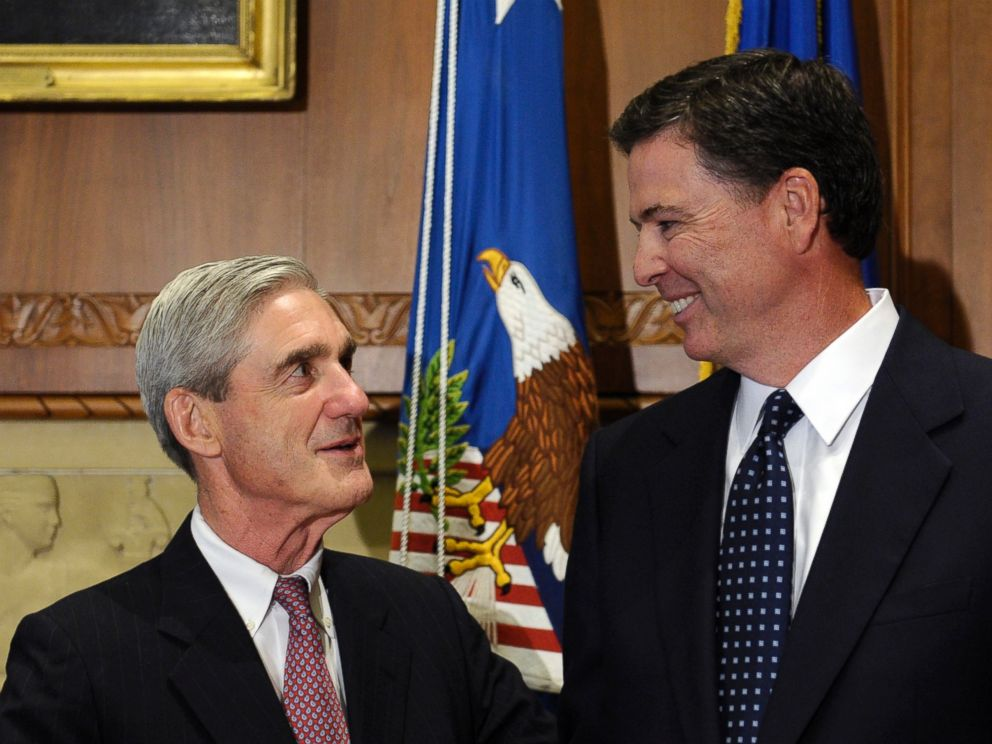 PHOTO: A Sept.4, 2013 file photo showing incoming FBI Director James Comey, right, talking with retiring FBI Director Robert Mueller at the Justice Department in Washington,D.C.