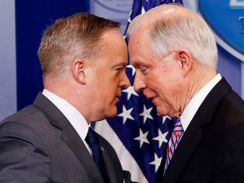PHOTO: White House press secretary Sean Spicer allows Attorney General Jeff Sessions to pass him after Sessions addressed members of the media during the daily briefing in the Brady Press Briefing Room of the White House in Washington, March 27, 2017.