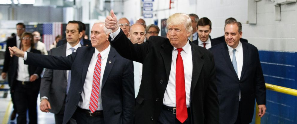 PHOTO: President-elect Donald Trump and Vice President-elect Mike Pence wave as they visit to Carrier factory, in Indianapolis, Indiana, Dec. 1, 2016.
