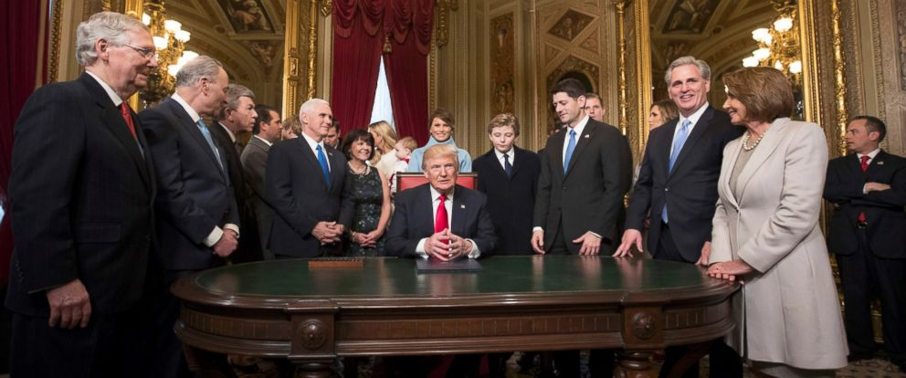 PHOTO: President Donald Trump is joined by the Congressional leadership and his family as he formally signs his cabinet nominations into law, in the Presidents Room of the Senate, at the Capitol in Washington, D.C.,Jan. 20, 2017.