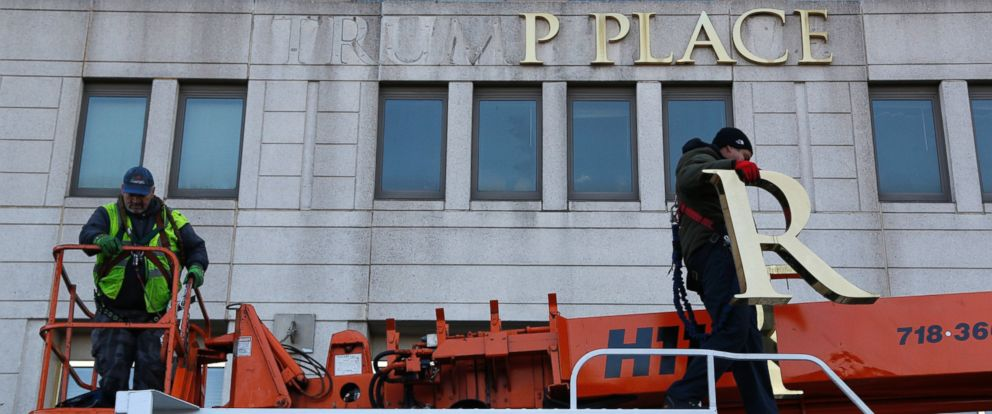 PHOTO: Workmen remove the letters from a building formerly known as Trump Place in New York, on Nov. 16, 2016.