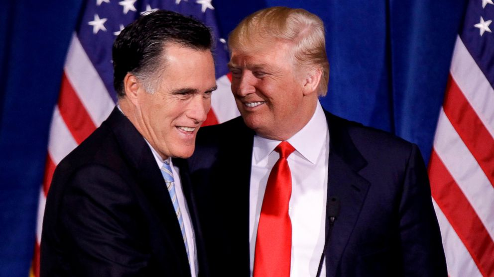 Donald Trump greets Republican presidential candidate, former Massachusetts Gov. Mitt Romney, after announcing his endorsement of Romney during a news conference, Feb. 2, 2012, in Las Vegas.