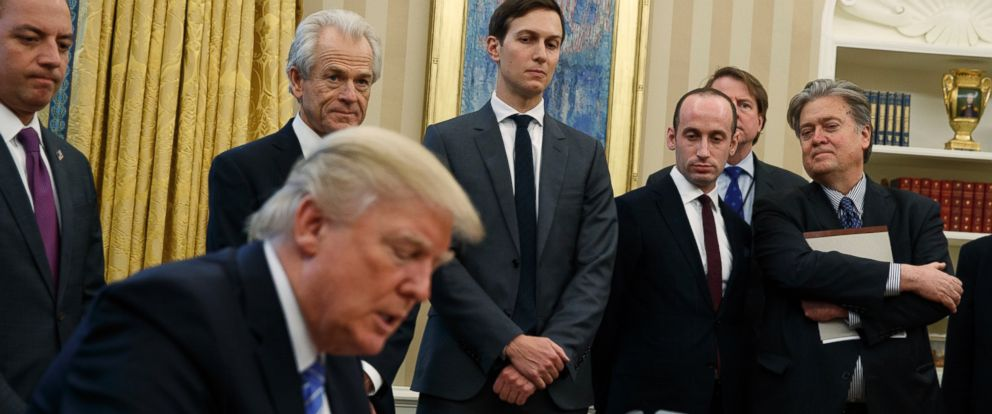 PHOTO: Chief of Staff Reince Priebus, National Trade Council adviser Peter Navarro, Senior Adviser Jared Kushner, policy adviser Stephen Miller, and chief strategist Steve Bannon watch as Donald Trump signs an executive order, Jan. 23, 2017, Washington.