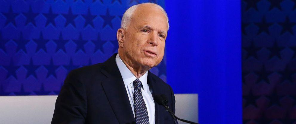 PHOTO: Arizona Republican Sen. John McCain talks with debate moderators prior to his debate with Democratic Rep. Ann Kirkpatrick, Oct. 10, 2016, in Phoenix.