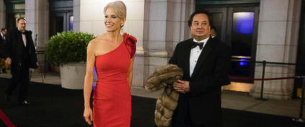 PHOTO: Kellyanne Conway, accompanied by her husband, George, speaks with members of the media as they arrive for a dinner at Union Station in Washington, the day before Trumps inauguration, Jan. 19, 2017.