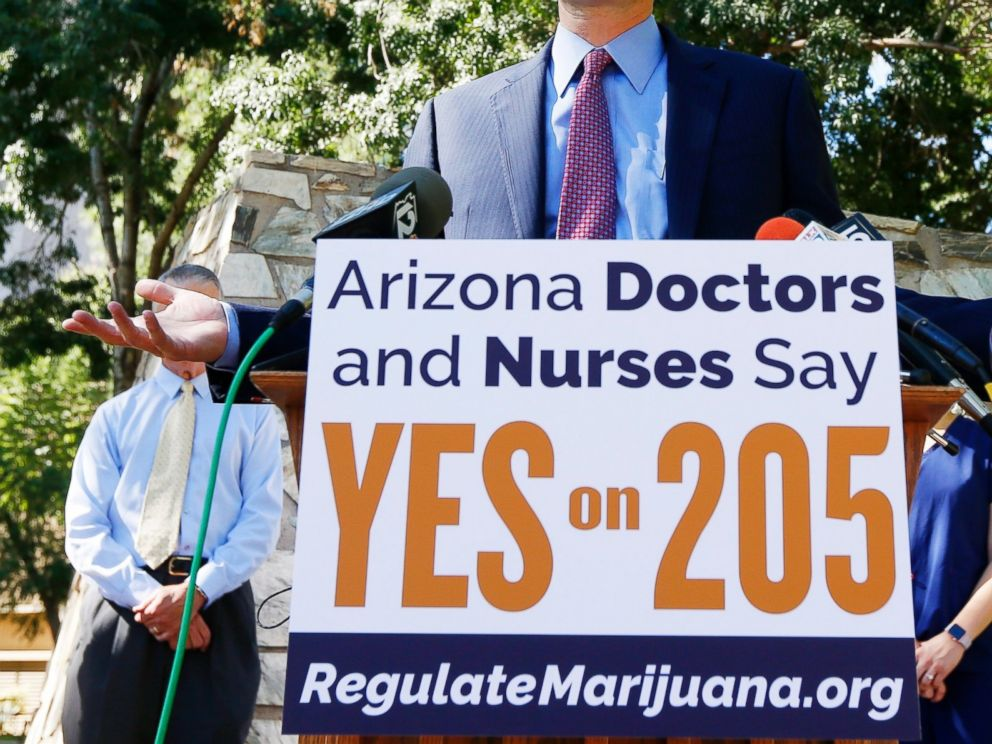 PHOTO: Doctors and nurses in Phoenix, Arizona at an event in front of the state capitol for Prop 205, the legalization of recreational marijuana, Oct. 26, 2016.