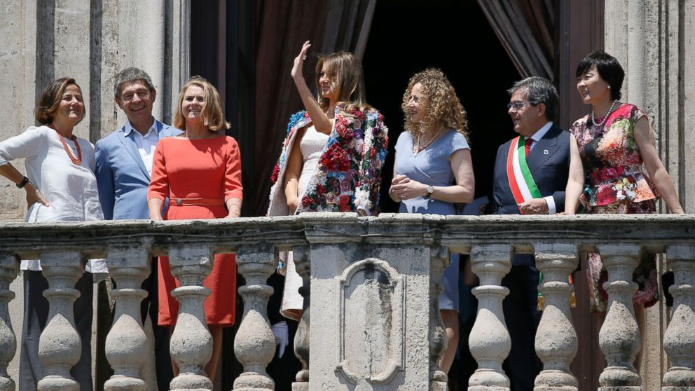First lady Melania Trump, center, waves as she stands with; from left, spouse of Italian Premier Paolo Gentiloni Emanuela Mauro, spouse of German Chancellor Angela Merkel Joachim Sauer, spouse of European Council President Donald Tusk Malgorzata Tusk, Amanda Succi, partner of the mayor of Catania Enzo Bianco, Mayor Bianco and spouse of Japanese Prime Minister Shinzo Abe Akie Abe, on the balcony of Chierici Palace, part of a visit of the G7 first ladies in Catania, Italy, May 26, 2017.