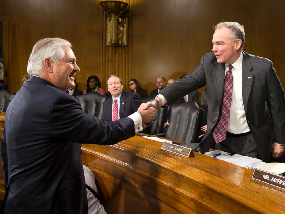 PHOTO: Senate Foreign Relations Committee member Sen. Tim Kaine, right, greets Secretary of State-designate Rex Tillerson on Capitol Hill in Washington, Jan. 11, 2017, prior to the start of Tillersons confirmation hearing before the committee.
