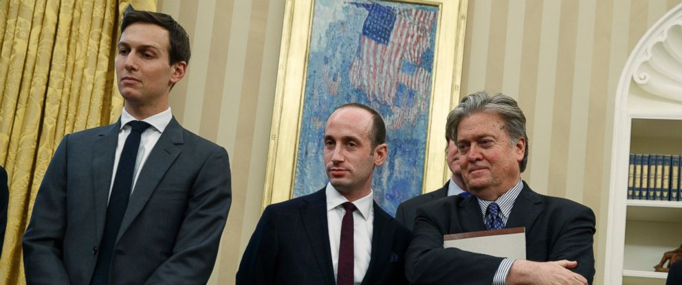 PHOTO: Policy adviser Stephen Miller and chief strategist Steve Bannon watch as President Donald Trump signs an executive order to withdraw the U.S. from the 12-nation Trans-Pacific Partnership trade pact, Jan. 23, 2017, in Washington.