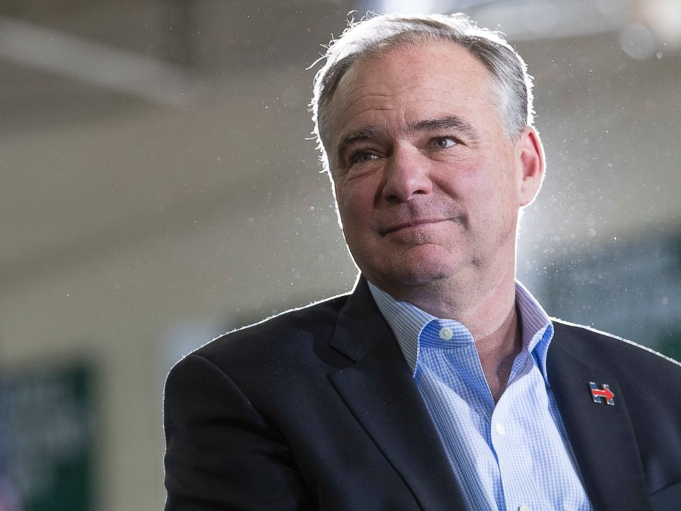 PHOTO: Democratic vice presidential candidate Sen. Tim Kaine listens as Democratic presidential candidate Hillary Clinton speaks during a campaign event at the Taylor Allderdice High School, Oct. 22, 2016, in Pittsburgh, Pennsylvania.