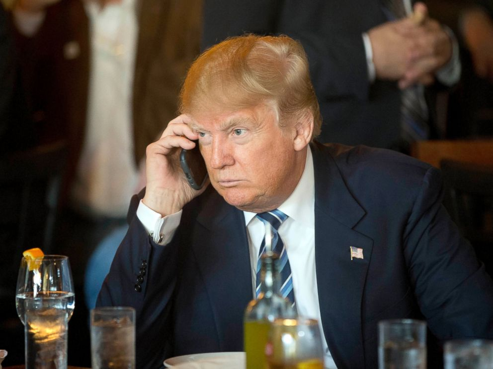 PHOTO: Donald Trump listens to his mobile phone during a lunch stop in North Charleston, S.C., Feb. 18, 2016.