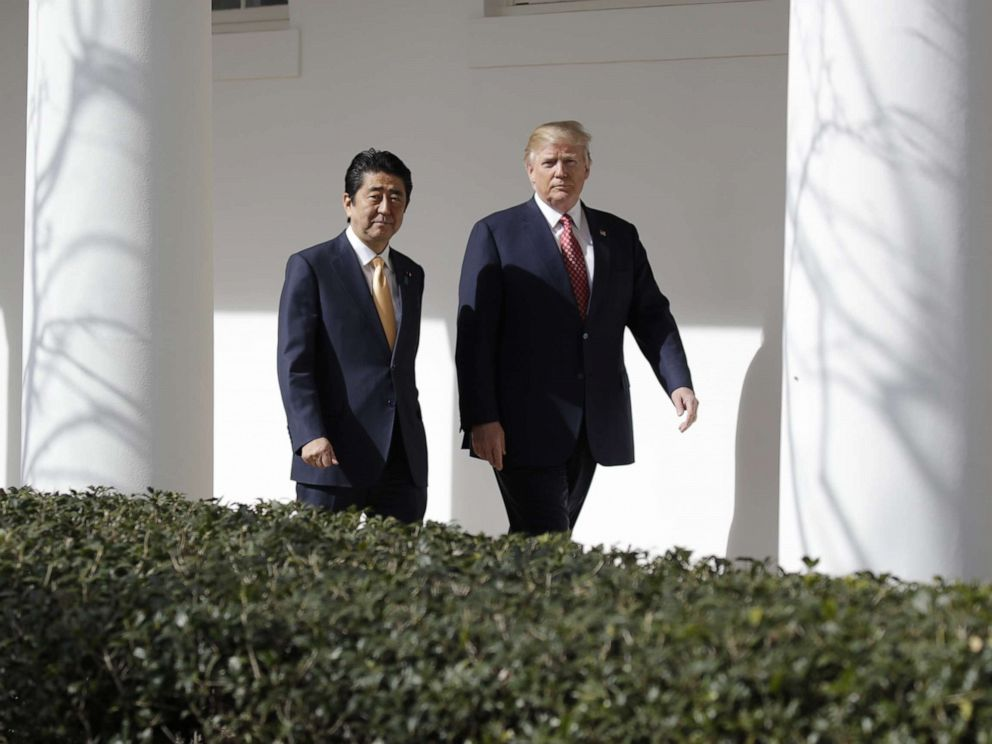 PHOTO: Donald Trump walks with Japanese Prime Minister Shinzo Abe at the White House in Washington, Feb. 10, 2017.