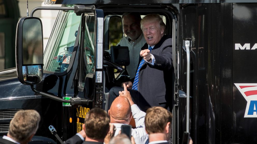 President Donald J. Trump sits in an 18-wheeler truck while meeting with truckers and CEOs regarding healthcare on the South Lawn of the White House in Washington, March 23, 2017.