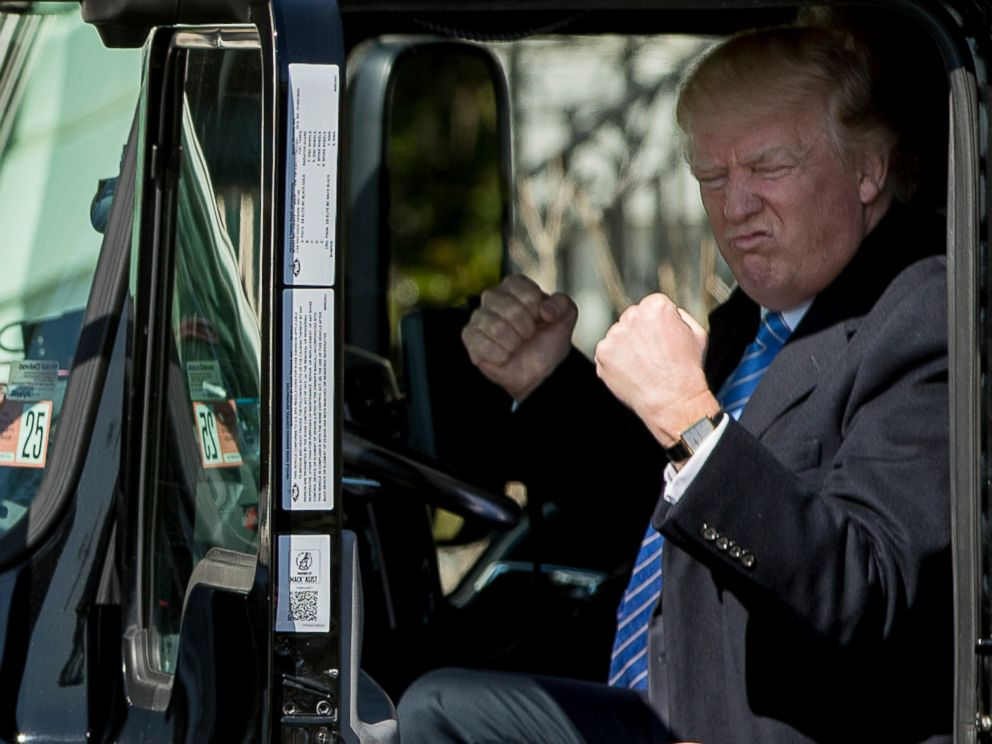 PHOTO: President Donald Trump gestures while sitting in an 18-wheeler truck while meeting with truckers and CEOs regarding healthcare on the South Lawn of the White House in Washington, March 23, 2017.