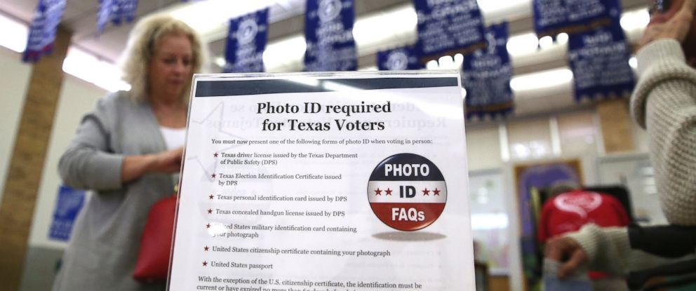 PHOTO: A sign tells voters of voter ID requirements before participating in the primary election at Sherrod Elementary school in Arlington, Texas, March 1, 2016.