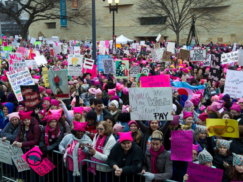 PHOTO: Women with bright pink hats and signs begin to gather early and are set to make their voices heard on the first full day of Donald Trumps presidency, Jan. 21, 2017 in Washington.