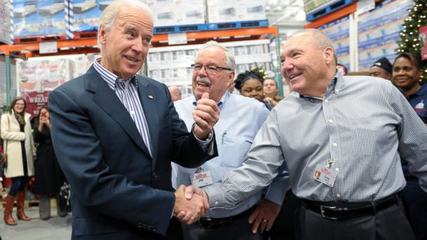 PHOTO: Vice President Joe Biden shakes hands with Costco CEO Craig Jelinek, right, as co-founder Jim Sinegal watches at center, after Biden arrived to shop at the new Costco store in Washington on Nov. 29, 2012.