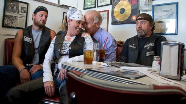 PHOTO: In this Sept. 9, 2012 file photo, Vice President Joe Biden talks to customers, including a woman who pulled up her chair in front of the bench Biden was sitting on, during a stop at Cruisers Diner in Seaman, Ohio.